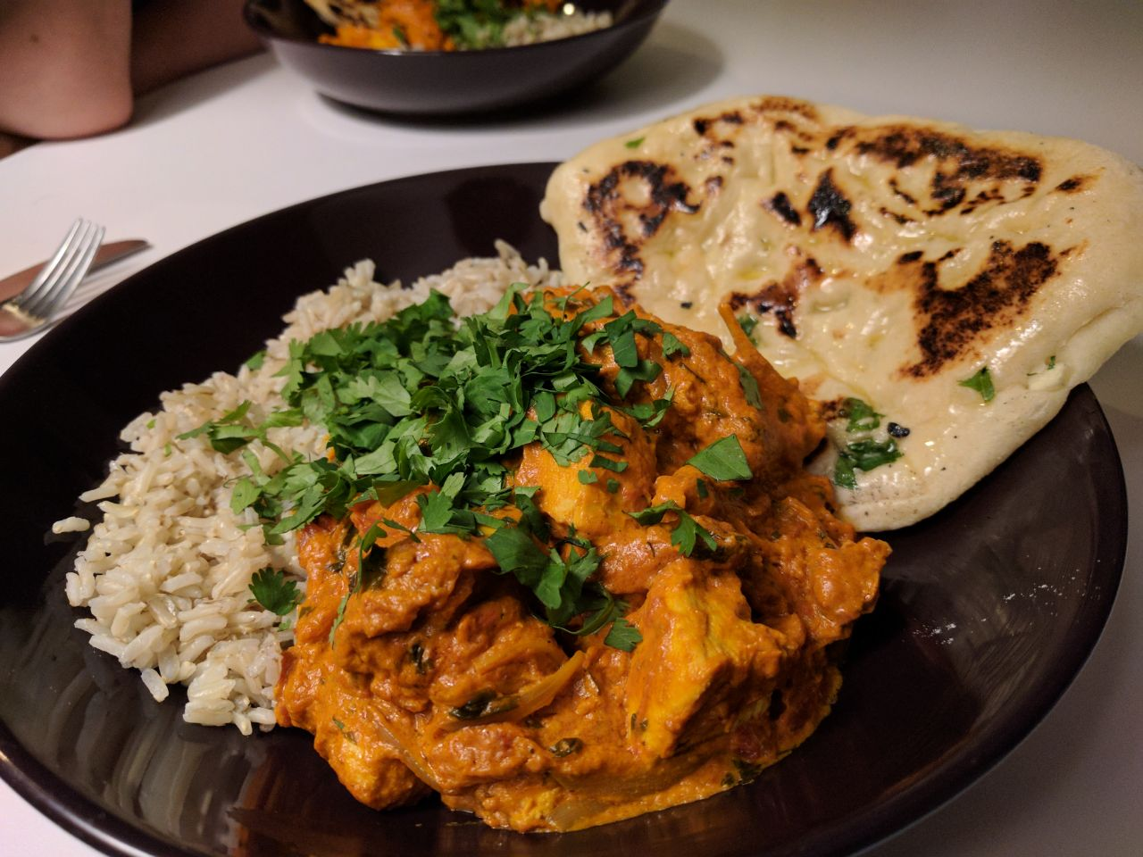 homemade chicken tikka masala with garlic naan