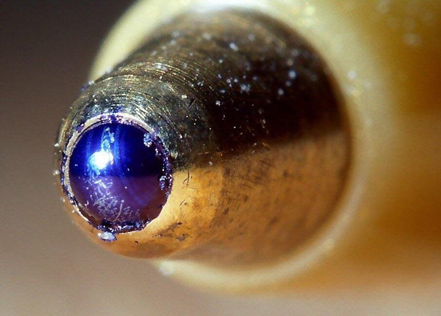 The ball of a ballpoint pen. Up close - poseitom - https-::bit.ly:2HT3zn3