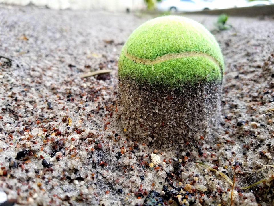 The way rain carved out the sand around this ball and 'elevated' it - DHubbage - bit.ly2x0C9GW