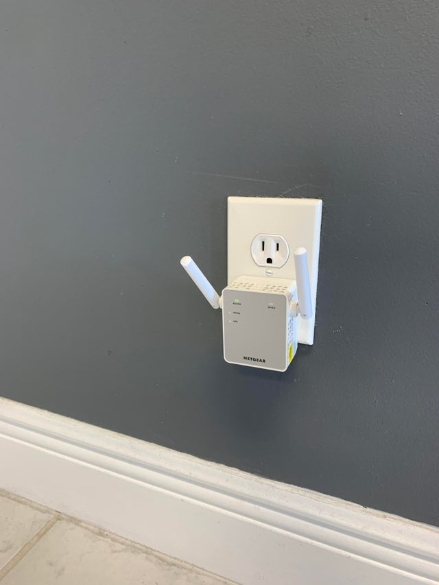 This WiFi extender makes this outlet look like he is in a panic