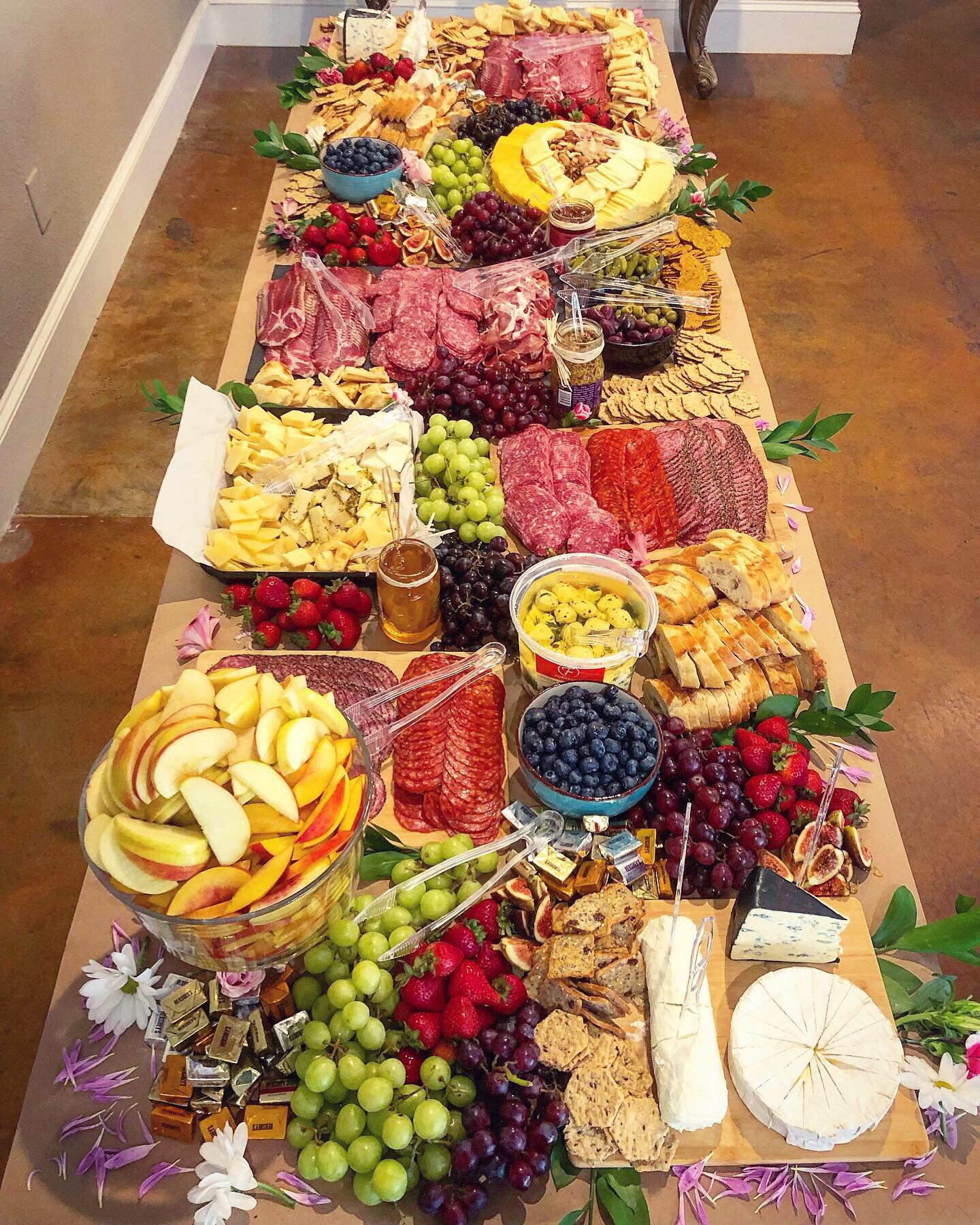 Assembled a meats, fruits, cheeses, nuts and more table