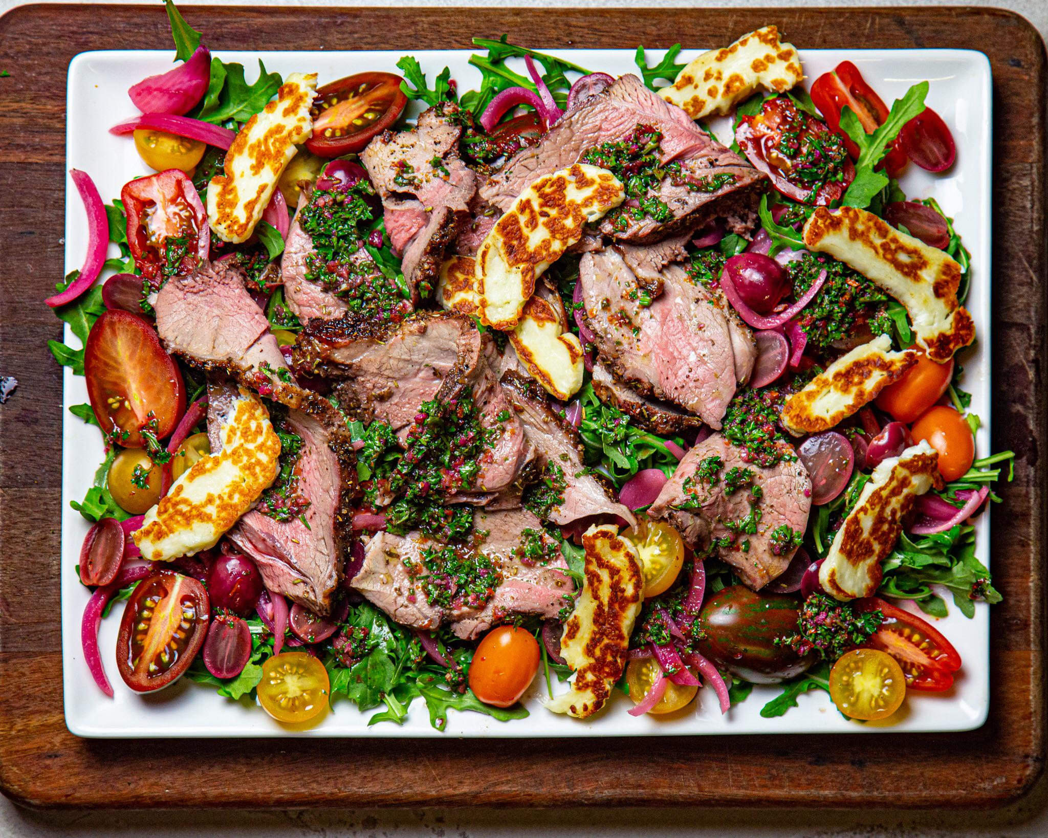 Lamb salad with pickled grapes and onions, halloumi and blood orange chimmichurri