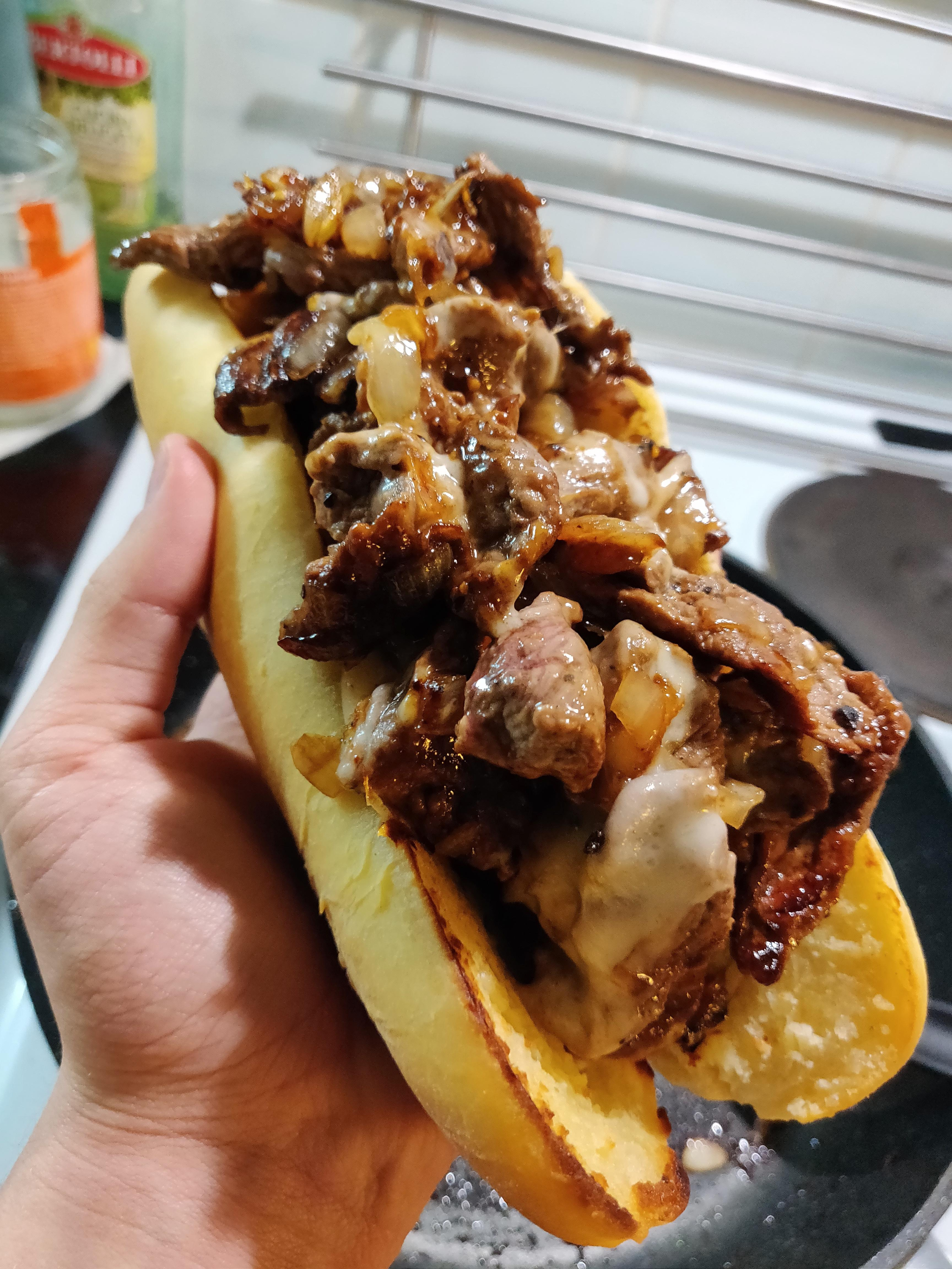 Cheesesteak with homemade hoagie roll and provolone