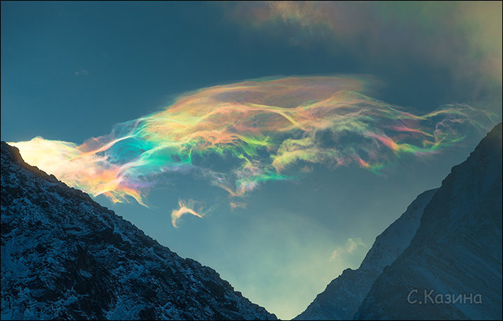 Stunning iridescent clouds snapped above skies of Siberia's Belukha mountain