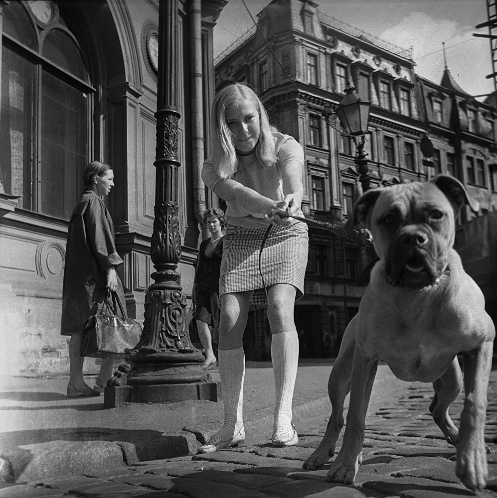 A girl and her curious dog, Soviet Riga, 1974
