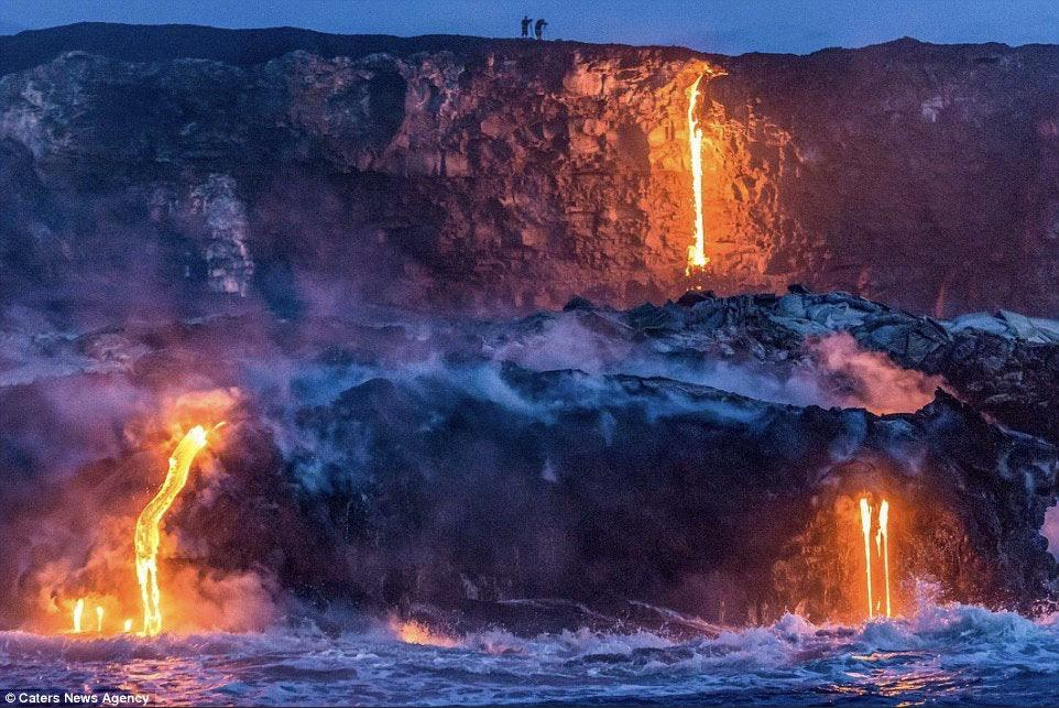 Rivers of molten lava pouring into the sea